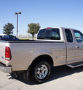 ford f 150 1998 tan xlt gasoline v8 rear wheel drive automatic with overdrive 76018