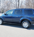 dodge durango 2005 dk  blue suv sxt gasoline 8 cylinders 4 wheel drive automatic with overdrive 56001