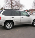 gmc envoy 2004 silver suv sle 4wd dvd gasoline 6 cylinders 4 wheel drive automatic 55124