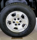 chevrolet tahoe 2011 black suv lt flex fuel 8 cylinders 4 wheel drive automatic 55124