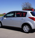 nissan versa 2011 silver hatchback gasoline 4 cylinders front wheel drive automatic with overdrive 76018