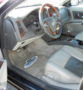 cadillac cts 2003 black sedan gasoline 6 cylinders rear wheel drive 5 speed manual 56301