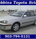 hyundai elantra 2005 silver hatchback gt gasoline 4 cylinders front wheel drive automatic 75503