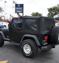 jeep wrangler 2006 black suv sport gasoline 6 cylinders 4 wheel drive 6 speed manual 33021