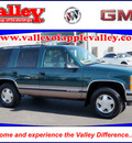 chevrolet tahoe 1999 green suv lt gasoline v8 4 wheel drive automatic 55124