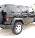 jeep wrangler unlimited 2011 black suv sport gasoline 6 cylinders 4 wheel drive automatic with overdrive 77065