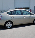 toyota prius 2009 tan hatchback standard hybrid 4 cylinders front wheel drive automatic 56001