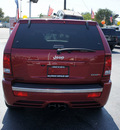 jeep grand cherokee 2010 red suv srt8 gasoline 8 cylinders 4 wheel drive automatic 33021