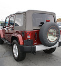 jeep wrangler unlimited 2010 red suv sahara gasoline 6 cylinders 4 wheel drive automatic 27215