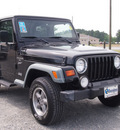 jeep wrangler 1999 black suv sport gasoline 6 cylinders 4 wheel drive automatic 27569