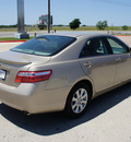 toyota camry 2009 gold sedan xle gasoline 4 cylinders front wheel drive automatic 76087