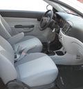 hyundai accent 2009 white hatchback gasoline 4 cylinders front wheel drive standard 79925