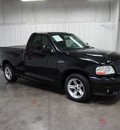 ford f 150 svt lightning 2003 black pickup truck gasoline 8 cylinders rear wheel drive automatic with overdrive 76108