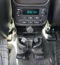 gmc envoy xl 2005 silver suv slt gasoline 6 cylinders rear wheel drive automatic 76087
