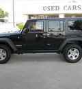 jeep wrangler unlimited 2011 black suv rubicon gasoline 6 cylinders 4 wheel drive 75080