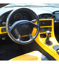 chevrolet corvette 2003 yellow coupe z06 gasoline 8 cylinders rear wheel drive 6 speed manual 77070