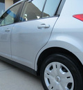 nissan versa 2010 silver hatchback 1 8 s gasoline 4 cylinders front wheel drive not specified 77099