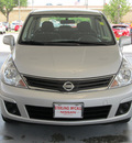 nissan versa 2011 silver sedan 1 8 s gasoline 4 cylinders front wheel drive automatic with overdrive 77477
