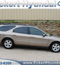 ford taurus 2003 beige wagon se gasoline 6 cylinders front wheel drive automatic 76210