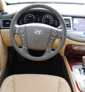 hyundai genesis 2012 black sedan 3 8l v6 gasoline 6 cylinders rear wheel drive automatic 76049