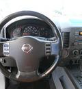 nissan titan 2004 silver gasoline 8 cylinders rear wheel drive automatic 79936