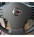 nissan armada 2004 brown suv se gasoline 8 cylinders rear wheel drive automatic 77094