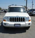 jeep commander 2010 white suv sport gasoline 6 cylinders 4 wheel drive automatic 79925