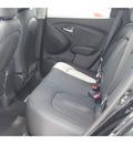 hyundai tucson 2012 black suv limited gasoline 4 cylinders front wheel drive autostick 77094