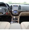 hyundai santa fe 2012 beige suv limited gasoline 6 cylinders front wheel drive autostick 77094
