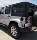 jeep wrangler unlimited 2012 bright silver suv sahara gasoline 6 cylinders 4 wheel drive automatic 77521