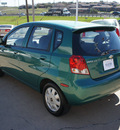 chevrolet aveo 2004 green hatchback ls gasoline 4 cylinders front wheel drive automatic with overdrive 76108