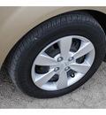 kia rio 2011 beige sedan lx gasoline 4 cylinders front wheel drive automatic 78861