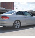 bmw 335i 2009 gray coupe gasoline 6 cylinders rear wheel drive automatic 77002