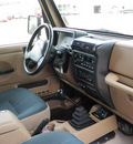 jeep wrangler 1999 lt  brown suv sahara gasoline 6 cylinders 4 wheel drive 5 speed manual 55318