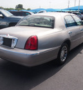 lincoln town car 2002 gold sedan signature gasoline 8 cylinders rear wheel drive automatic 76234