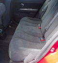 nissan versa 2011 red hatchback 1 8 gasoline 4 cylinders front wheel drive automatic 76234