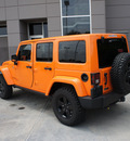 jeep wrangler unlimited 2012 orange suv rubicon gasoline 6 cylinders 4 wheel drive automatic 76108