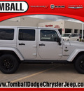 jeep wrangler unlimited 2012 bright silver suv rubicon gasoline 6 cylinders 4 wheel drive automatic 77375