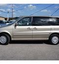 kia sedona 2004 beige van lx gasoline 6 cylinders front wheel drive automatic 78654