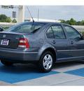 volkswagen jetta 2004 gray sedan gls 1 8t gasoline 4 cylinders front wheel drive automatic 77094