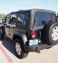 jeep wrangler unlimited 2011 black suv sport gasoline 6 cylinders 4 wheel drive automatic with overdrive 75093