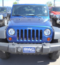 jeep wrangler unltd 2009 blue suv rubicon gasoline 6 cylinders 4 wheel drive automatic 79925