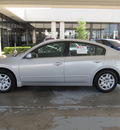 nissan altima 2009 silver sedan 2 5 s gasoline 4 cylinders front wheel drive shiftable automatic 77477