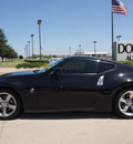 nissan 370z 2009 black coupe gasoline 6 cylinders rear wheel drive 6 speed manual 76018
