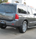 nissan armada 2011 dk  gray suv platinum flex fuel 8 cylinders 2 wheel drive automatic with overdrive 77477