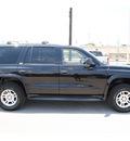 dodge durango 2002 black suv slt gasoline 8 cylinders 4 wheel drive automatic with overdrive 77037