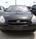 hyundai accent 2009 black hatchback gs gasoline 4 cylinders front wheel drive 5 speed manual 33157