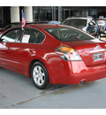 nissan altima 2009 dk  red sedan 2 5 s gasoline 4 cylinders front wheel drive automatic with overdrive 77477