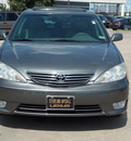 toyota camry 2005 gray sedan xle v6 gasoline 6 cylinders front wheel drive automatic with overdrive 77074