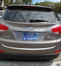 hyundai tucson 2012 brown limited gasoline 4 cylinders front wheel drive automatic 94010